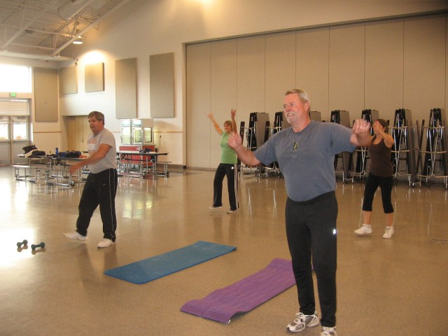 Marty Miller, (r), and Kevin Miller, (l), jazzercising in Graham.