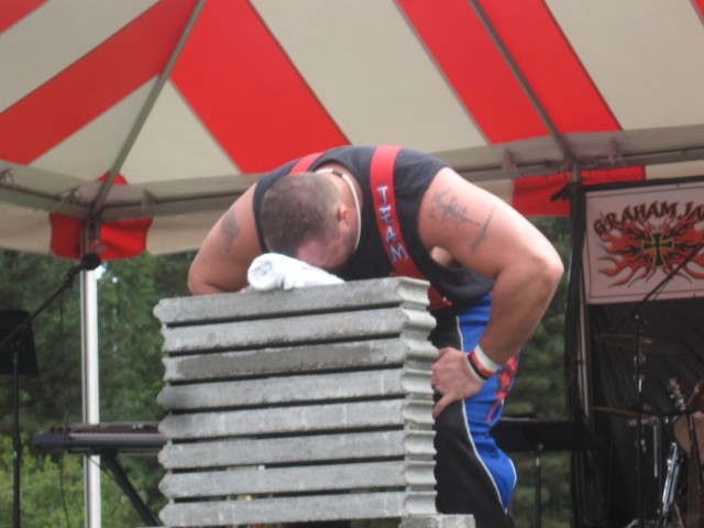 "Power Team strongman - and former Atlanta Falcon footballer - Matt Dobson prepares to ""smash some stuff"" with his forehead."