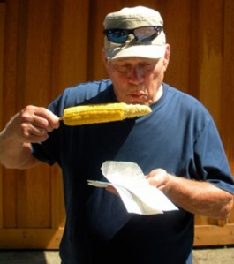 Jerry Lassiter eating corn at the Pierce County Fair