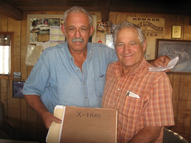 "The Fazio brothers, Ricard, l, and Al, r, displaying their ""X-Files"" folder, containing pictures of the cattle mutilations that occured in 1991."