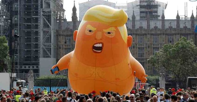 Demonstrators fly a blimp portraying U.S. President Donald Trump, in Parliament Square, during the visit by Trump and First Lady Melania Trump in London